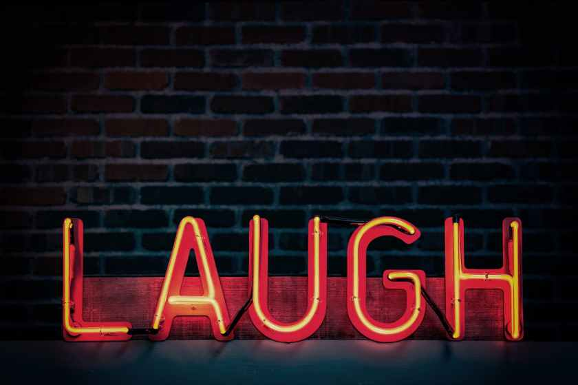 laugh neon light signage turned on